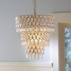 Three tiers of sparkling crystals give this chandelier a serious and dramatic look. #nursery #lighting