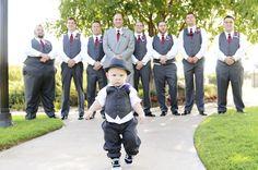 What an adorable ring bearer. Love it! www.jessicanadine.com wedding photography. #groomsmen #pose