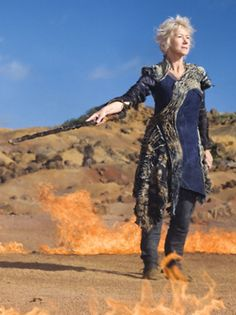 Helen Mirren in The Tempest.  I don't actually want to copy this, but the outfit is interesting.  But our Prospero should be wearing something long & flowy.  The colors and style are right - Miranda dresses light, Prospero dresses dark - but Michaela needs a dress or robe or something.