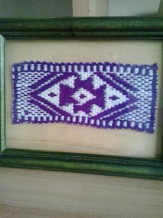 Mapuche Cross, on wood frame . Ñimikan Technique