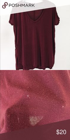 Brandy Melville Maroon Top Has 3 tiny little holes. Other than that is in good condition. Super soft material Brandy Melville Tops Tees - Short Sleeve