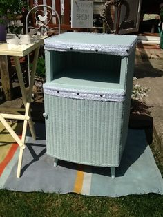 Lloyd loom bedside painted birds nest blue with lace trim x