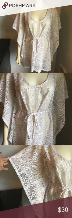 White swimsuit cover This cover up is perfect for wearing over a bathing suit for a little more coverage. Batwing sleeve add a nice touch. Hits low enough to cover your bottom. Nice crisp white. Gently worn. Non smoking home. Swim Coverups