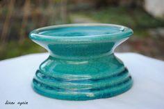 turquoise ceramic candle holder.