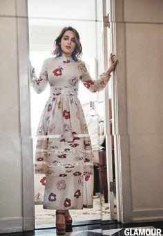 Emilia Clarke wears a long-sleeve Rochas floral print dress with platform heels