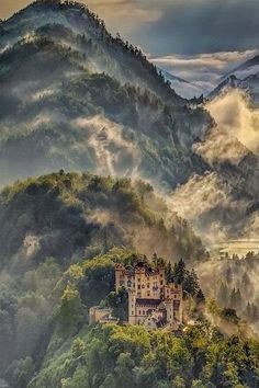 The Neuschwanstein Castle in Germany, nestled in the mountains.