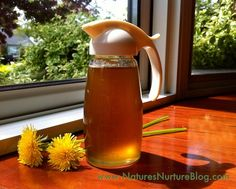 Homemade Dandelion Syrup : Nature's Nurture and since I always have an abundant crop of Dandelions and cooking with them I think I need to make some syrup this spring! Dandelion Syrup atop fresh of the waffle iron gluten free waffles! Pavlova, Sangria, Dandelion Recipes, Chutney, Wild Edibles, Liqueur, Cancer Cure, Fighting Cancer, Pancakes And Waffles