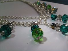 Swarovski crystal and glass bead multichain necklace.