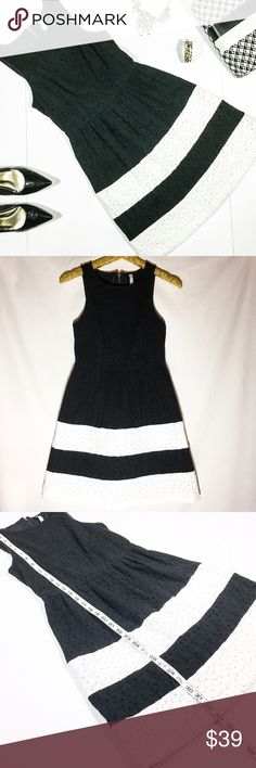 Kensie Black & White Eyelet Fit and Flare Dress This fabulous and flattering dress from Kensie is absolutely stunning! Classic and chic fit and flare style with this white stripes along the bottom half, and beautiful floral eyelets that are so in style right now! Fully lined and closes with a back exposed zipper. This adorable dress is preloved in GUC, with no apparent flaws and lots of life left! Kensie Dresses Midi