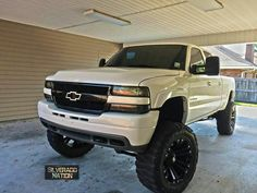 White lifted Chevy Silverado truck BRUHHH GIMME DISSSS RIGHT NOWWW!!!!!!!!! I LOVE IT!!!