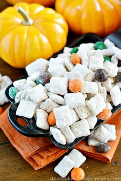 Pumpkin Spice Muddy Buddies make a great fall dessert for Fall parties, as Halloween treats, and picnics at the pumpkin patch! This muddy buddies recipe, also known as puppy chow, is filled with pumpkin pie spice and pumpkin spice M&M's. Pumpkin Recipes, Fall Recipes, Holiday Recipes, Snack Recipes, Dessert Recipes, Snacks, Holiday Meals, Dessert Ideas, Easy Desserts