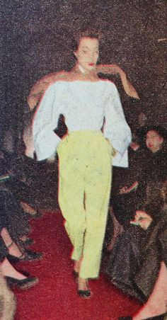 Hubert de Givenchy- 1952 White Martinique blouse with wide sleeves over green flannel trouser pants. Elle- Les Collections Printemps 1952- No.327- March 3, 1952.
