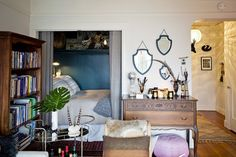 Sarah's Curio Filled Studio-Great use of space, the little bed nook looks like it used to be a wardrobe :)