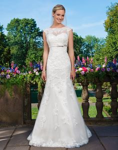 Sincerity wedding dress style 3871 Beaded embroidered lace, tulle and satin fit and flare highlighted with a sweetheart neckline.
