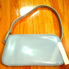 Reduced! NWT Sequoia Paris Baby Blue Leather Bag Pastels are in!!! This Powder Blue Sequoia Paris Shoulder bag with its minimalist design is the perfect accessory for any Spring/Summer outfit. The Cool Blue Hue also transitions nicely into Winter and its style is timeless. Brand New w/ tags, Outside Pocket on the back side and Sequoia Signature Ring detail on the side. Bags