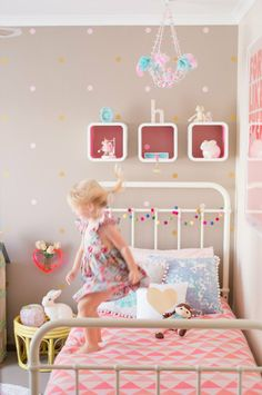 Holly's DIY Delight  My Room -- ok it's a child's room but i love those pom poms on the headboard & the pink chair!
