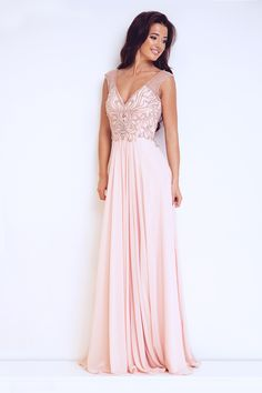 f918a03f39 This low v neck pink evening dress by dynasty london was designed as part  of their