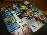 Great use of book covers from weeded books (ones that are getting tossed/sold).  Decoupage them and make a sweet tabletop. Even better with a glass panel on top to avoid tearing.