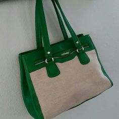 Olivia & Joy Canvas purse Olivia & Joy green & Canvas purse. So many pockets & compartments. Great bag for travel or mom's on the go. New without tags! Olivia + Joy Bags Totes