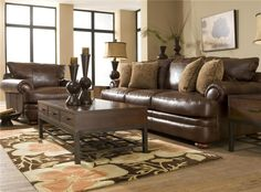 beautiful leather couch, love the tone on tone brown with the lighter shade for the wall...