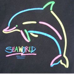 Awesome vintage 90's Seaworld tourist print t-shirt! This piece is from the Seaworld Park on the Gold Coast Australia circa 1995 (check out the label). It features a fluro rainbow screen printed dolphin logo with 'Seaworld' underneath. With short sleeves in a soft worn black cotton fabric. A really cool piece to wear with jeans, skirts, shorts or anything you can think of! This is a children's tee but does fit smaller sized ladies so you can re-live a little childhood nostalgia.  SIZING AND…
