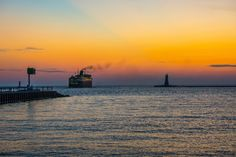 Sunset Ferry on Lake Michigan passes Lighthouse in Ludington, Michigan Photo Detroit Area, Metro Detroit, White Lake Michigan, Ludington Michigan, Lake Shore, Labour Day Weekend, Wall Street Journal, Rolling Stones, Mississippi