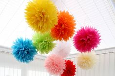 10 pounds- Pack of 4 pointed tissue paper pom poms, by Light a Lantern at www.notonthehighstreet.com  Can buy in white, plus other colours. 15 inches diameter.