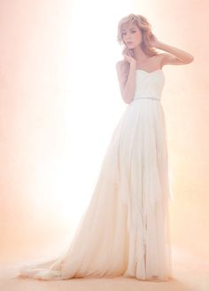 Style 1407 > Bridal Gowns, Wedding Dresses > Blush by Hayley Paige > Shown Ivory strapless A-line gown with English Net ruched Sweetheart bodice. Lace Beaded Trim at waist & Handkerchief layered skirt with Chapel Train (catalogue pic)