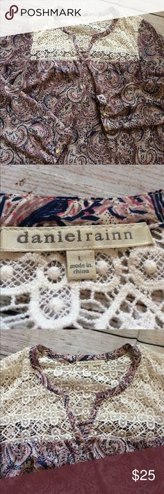 """Daniel Rainn  Blouse Crochet Paisley Tab Sleeve L Pre-owned condition with some light stains on the tag. Pit to pit 22"""". Length (mid shoulder to bottom hem) 26.5"""". Sleeve (shoulder hem to end of sleeve) 24"""".    100% Polyester.    The Crochet part is see through as it is cut outs. Daniel Rainn Tops Blouses"""
