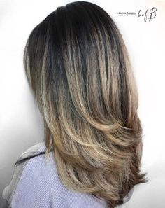 Haircut With Long Feathered Layers
