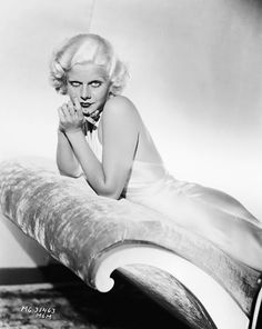 Jean Harlow, 1932  She brought Madeleine Vionnet's backless evening gown (introduced to couture customers in Europe around 1930) to America and inspired women everywhere to pick up bottles of peroxide for their hair.