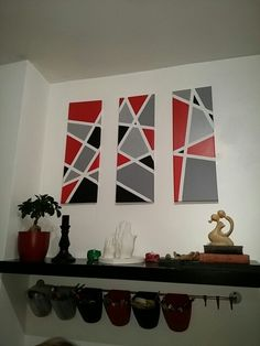 DIY geometric canvas art Made for our kitchen wall using masking tape and left over paint and paint samples. It really brightens the room and picks out our accent colour of red.