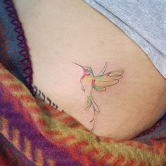 Watercolor/sketch style hummingbird tattoo on the pelvis.Done by Doy