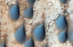 The Amazing Morphing Dunes of Mars MAY 5, 2014 These raindrop-shaped dunes are found in Copernicus Crater and are known to be rich in the mineral olivine, a mineral that formed during the wet history of Mars' evolution. READ MORE: Mars' 'Raindrop' Sand Dunes Swarm NASA/JPL-CALTECH/UNIVERSITY OF ARIZONA