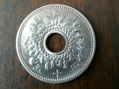 Between 1959 and 1966, the design on the Japan 50 yen coin was much more ornate than it is today.