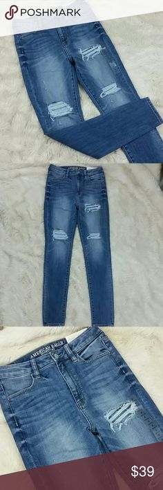 """American Eagle Jegging Hi Rise Skinny Jean Size 8 American Eagle Jeggings in the Super Hi Rise. Destroyed look with factory rips and distressing throughout.  Super stretch fits like a jegging but feels and looks like a jean with a super skinny tapered leg and button and zip fly with function pockets. New with tags. Size 8.  Waist 14.5"""" Rise 11"""" Inseam 29"""" Leg Opening 4.5"""" American Eagle Outfitters Jeans Skinny"""