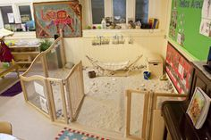 Indoor sandpit - no water play like outside but does eliminate concerns about creepy crawlies, mould and soiling by pets. Line floor with pale-coloured sturdy plastic stretched across floor.