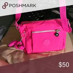Kipling pink cross body bag Kipling in excellent condition used once no damages at all pink cross body bag with a adjustable strap and light cream colored interior comes with a monkey keychain the monkeys name is Emmy and the monkey is medium in size very nice roomy bag medium in size Kipling Bags Crossbody Bags