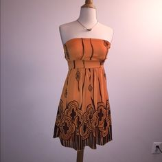 ⭐️ BOGO! Orange Delicate Strapless Tunic/Dress ⭐️ BOGO! Sheer orange with brown strapless tunic or dress. Size Sm, worn only a couple of times. Great with jeans and a sexy high sandal or alone with ballet flats. Offers welcome. *** Eligible for Buy One, Get One 50% off! Item must be of equal or less value. *** B Tru Dresses