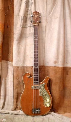 This vintage guitar was made by the Multivox company with their Premier brand name.  The bass sho...