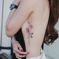 Flower Tattoo by 타투이스트. 타투이스트 꽃 artist works on women's tattoos and works exclusively for women. Continue Reading and for more Flower Tattoo designs → View Website Delicate Flower Tattoo, Flower Tattoo On Ribs, Small Flower Tattoos, Flower Tattoo Designs, Small Tattoos, Rib Tattoos For Women, Tattoo Designs For Women, Tattoos For Guys, Pretty Tattoos