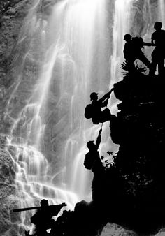 Doan Cong Tinh North Vietnamese scouts attempting to make a passage through the rapids for the logistics units following them with supplies of food and munitions. 1970