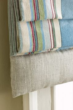Stuffed padded edges on Roman blinds.  You can make rounded ones or ones like this like made from Pure Linen with Monaco ticking