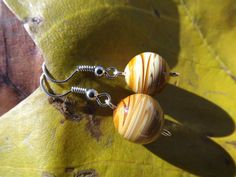 Tan swirl bead earrings