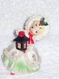 Vintage Christmas Napco Girl Shopper Porcelain Figurine Ornament Decoration Japan Spaghetti Trim. $75.00, via Etsy.