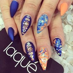 Royal blue and sun-kissed orange nails with multicolored Swarovski crystals.