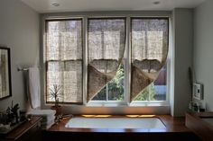 Inspired by the window covers in a living room by Commune Design, SF blogger and hands-on remodeler Caitlin Long of the Shingled House whipped up her own burlap version. Start to finish time for three panels: five hours.