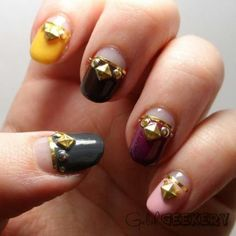 Fall Gelish nails with studs and gold striped tape!