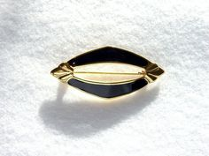 Art Deco brooch in a shield design. Black and gold by SellTheOld, $10.00