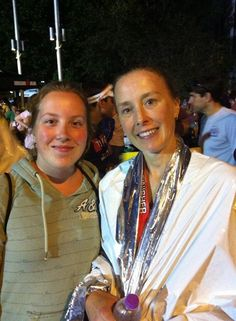 Ironman WI 2014: Sharing a victory moment with my handler and my daughter, Elise. Seeing her on the course motivated me to keep going. She needed to see her Mama be badass!